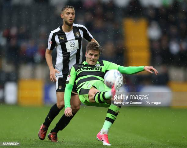 Notts County's Jorge Grant and Forest Green Rovers' Charlie Cooper during the match at Meadow Lane Nottingham