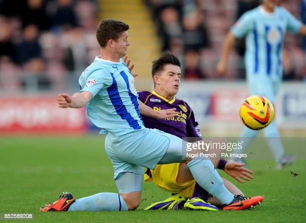 Notts County's Joss Grealish and Aaron Phillips battle for the ball during the Sky Bet League One match at Sixfields Northampton