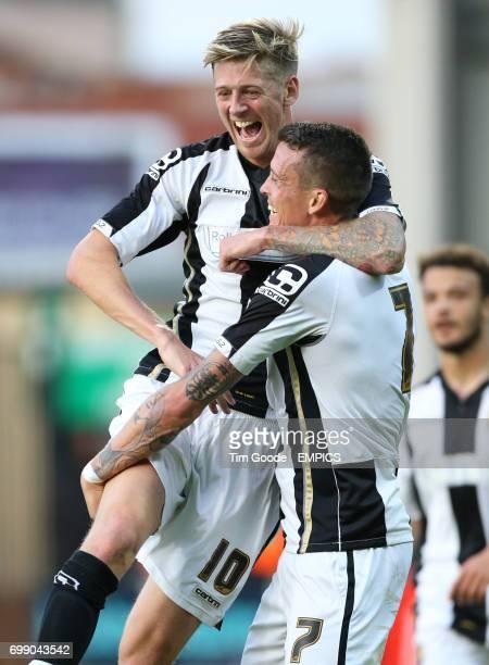 Notts County's Julian Jenner celebrates scoring his team's first goal of the game alongside teammate Jon Stead