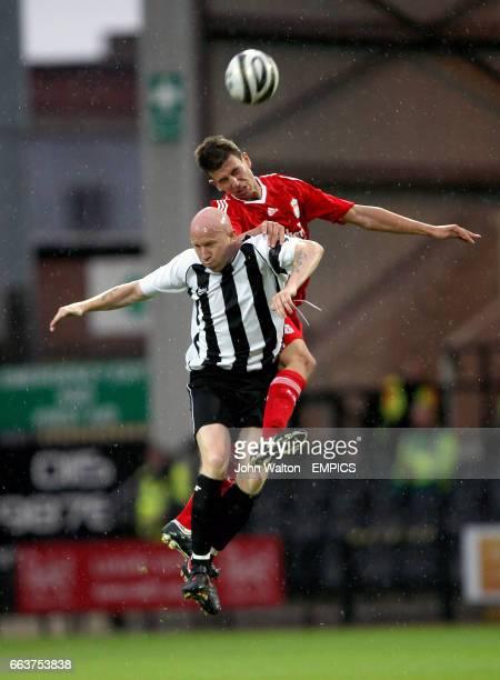 Notts County's Lee Hughes and Liverpool XI's Daniel Sanchez Ayala