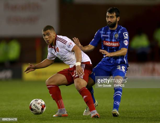 Notts County's Mike Edwards and Sheffield United's Che Adams battle for the ball