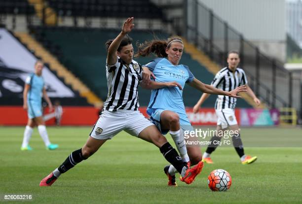 Notts County's Rachel Williams and Manchester City's Jill Scott battle for the ball