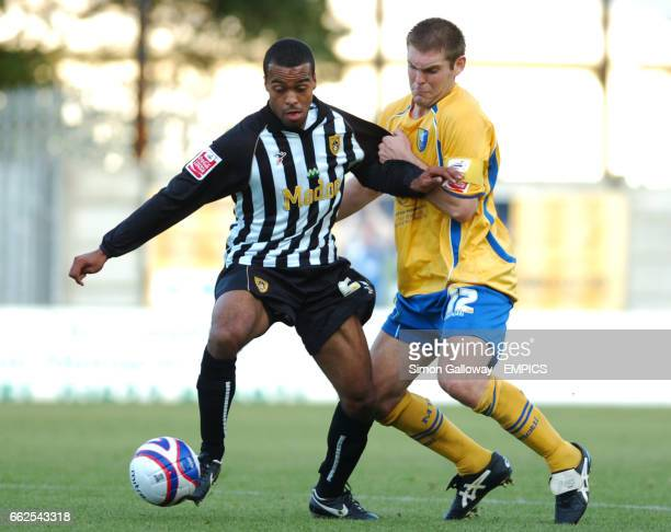 Notts County's Spencer WeirDaley and Mansfield Town's Jake Buxton in action