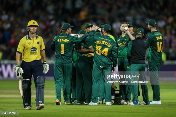 Notts Outlaws players celebrate with a drink after dismissing Birmingham Bears' Sam Hain during the NatWest T20 Blast Final match between Birmingham...