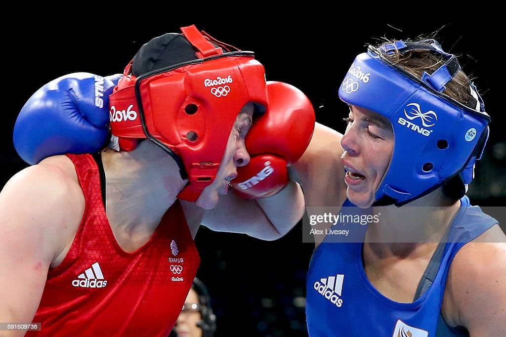 Nouchka Fontijn of the Netherlands throws a right at Savannah Marshall of Great Britain in the Women's Middleweight Quartefinal bout during Day 12 of the Rio 2016 Olympic Games at Riocentro - Pavilion 6 on August 17, 2016 in Rio de Janeiro, Brazil.