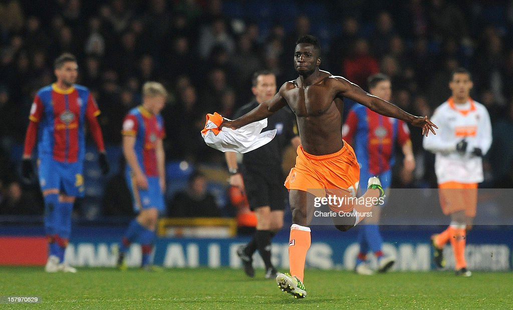 Nouha Dicko of Blackpool celebrates with his shirt off after scoring his late equaliser during the npower Championship match between Crystal Palace and Blackpool at Selhurst Park on December 08, 2012 in London, England.
