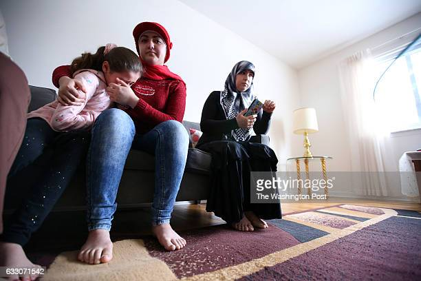 Nour Badat age 16 consoles her younger sister Judy Badat age 8 who misses her older sister Together with their mother Maysaa Waidh age 43 who arrived...