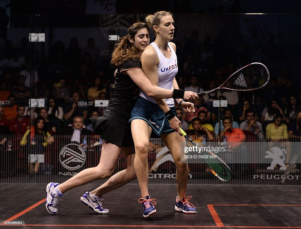 Nour El Sherbini of Egypt (L) collides with Laura Massaro of England (R) during their final match of the PSA Women's World Championships squash tournament in Bukit Jalil, oustide Kuala Lumpur on April 30, 2016. / AFP / MOHD