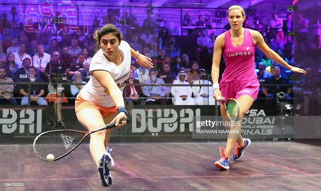 Nour El Sherbini (L) of Egypt plays a backhand to Laura Massaro of Great Britian during their semi-final match of the Dubai PSA World Series Finals squash tournament in Dubai on May 27, 2016. / AFP / MARWAN