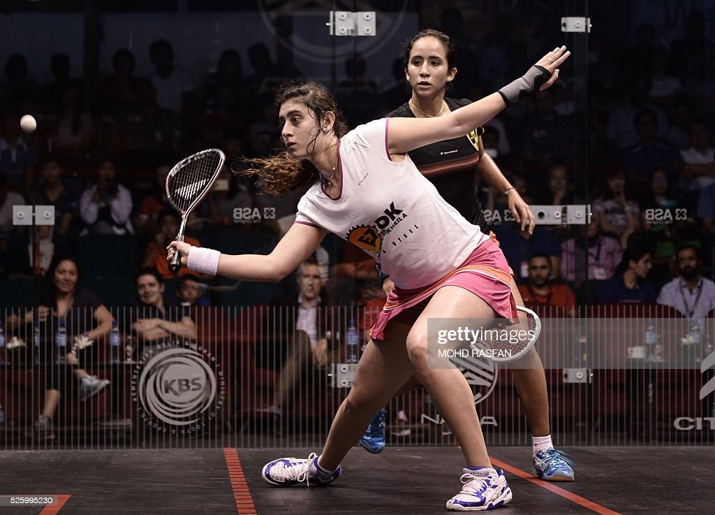 Nour El Sherbini of Egypt (L) plays a forehand against her compatriot Nouran Gohar (R) during their semi-final match of the PSA Women's World Championships squash tournament in Bukit Jalil, oustide Kuala Lumpur on April 29, 2016. / AFP / MOHD