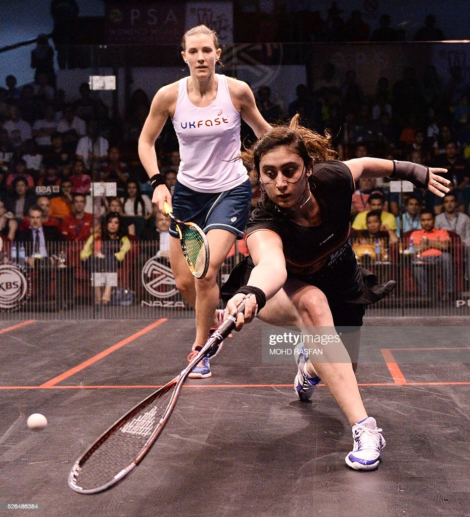 Nour El Sherbini of Egypt (R) plays a forehand against Laura Massaro of England (L) during their final match of the PSA Women's World Championships squash tournament in Bukit Jalil, oustide Kuala Lumpur on April 30, 2016. / AFP / MOHD