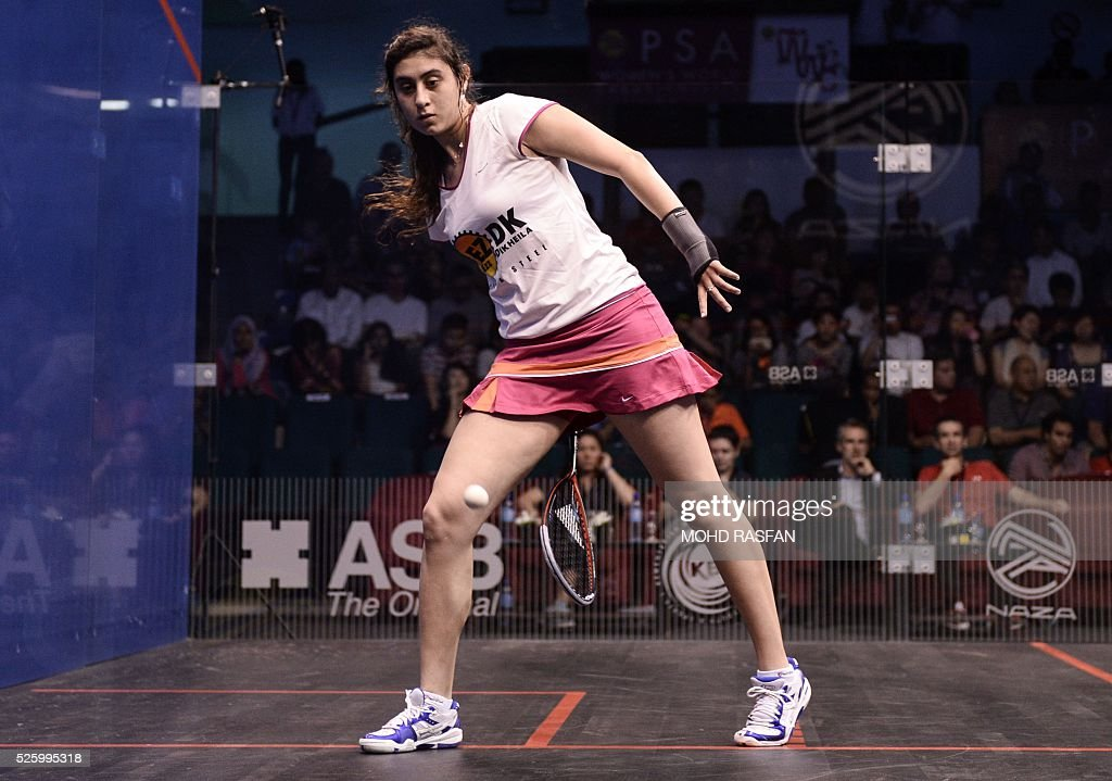 Nour El Sherbini of Egypt warms up before playing against compatriot Nouran Gohar (unseen) during their semi-final match of the PSA Women's World Championships squash tournament in Bukit Jalil, oustide Kuala Lumpur on April 29, 2016. / AFP / MOHD