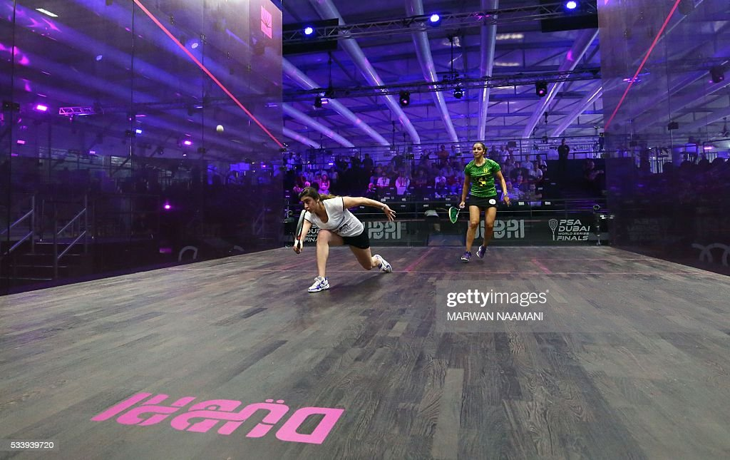 Nour el-Sherbini of Egypt (R) plays a backhand against her compatriot Raneem al-Welily during their match of the Dubai PSA World Series Finals squash tournament in Dubai, May 24, 2016. / AFP / MARWAN