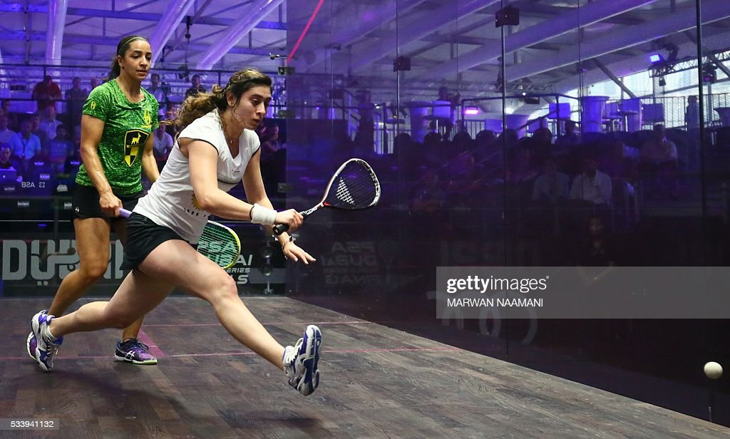 Nour el-Sherbini of Egypt (R) plays a backhand against her compatriot Raneem al-Welily during their match of the Dubai PSA World Series Finals squash tournament in Dubai on May 24, 2016. / AFP / MARWAN