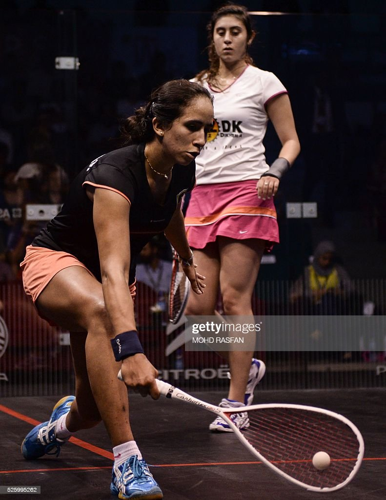 Nouran Gohar of Egypt (L) plays a forehand against her compatriot Nour El Sherbini (R) during their semi-final match of the PSA Women's World Championships squash tournament in Bukit Jalil, oustide Kuala Lumpur on April 29, 2016. / AFP / MOHD
