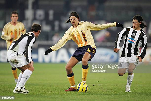 Nourdin Boukhari of Ajax is watched by Alessandro Birindelli and Mauro Camoranesi of Juventus during the UEFA Champions League Group C match between...