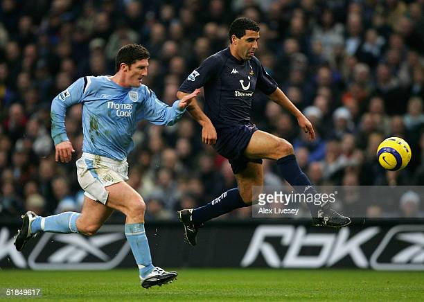 Noureddine Naybet of Tottenham Hotspur beats Jon Macken of Manchester City during the Barclays Premiership match between Manchester City and...