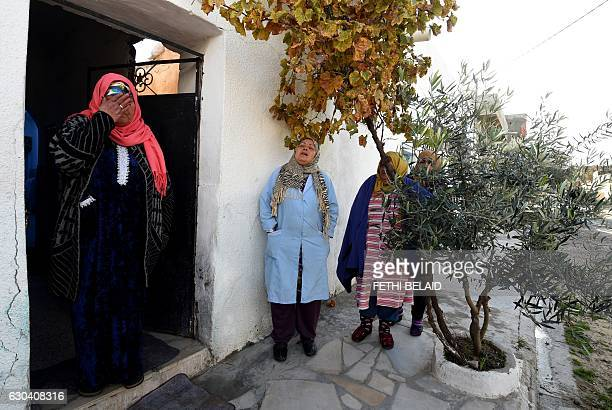 NourHouda Amri the mother of 24yearold Anis Amri the prime suspect in Berlin's deadly truck attack reacts in front her house in the town of Oueslatia...