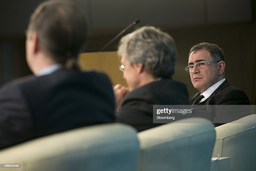 <a gi-track='captionPersonalityLinkClicked' href=/galleries/search?phrase=Nouriel+Roubini&family=editorial&specificpeople=5585642 ng-click='$event.stopPropagation()'>Nouriel Roubini</a>, co-founder and chairman of Roubini Global Economics LLC, right, listens at a macro policy discussion during the International Monetary Fund (IMF) and World Bank Group Spring Meetings with Roberto Perotti, professor of economics at Universita Bocconi, center, and Anders Borg, Sweden's finance minister, in Washington, D.C., U.S., on Wednesday, April 17, 2013. As much as 20 percent of non-bank corporate debt in the weakest euro-area economies is unsustainable and may force companies to cut dividends and sell assets, dealing further blows to investor confidence, the IMF said. Photographer: Andrew Harrer/Bloomberg via Getty Images