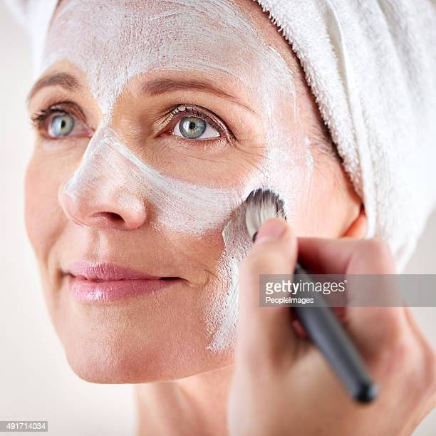Nourishing her skin with a facial treatment