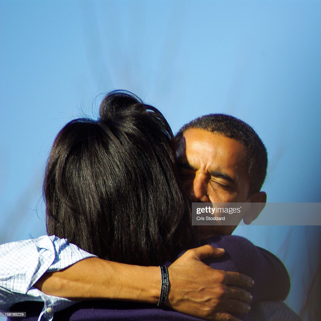 Pueblo, CO Obama Campaign Rally This photograph is special because it captures a personal moment between husband and wife, in front of a great public, and conveys an emotion we don't normally see.