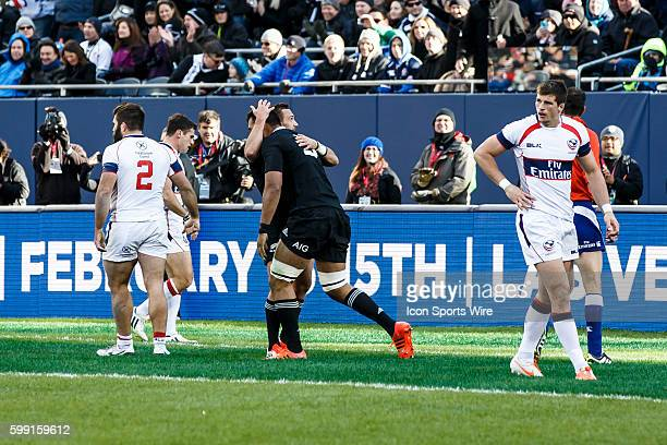 NZ All Blacks Flyhalf Aaron Cruden congratulates Second Row Patrick Tuipulotu after a try as USA Eagles Left wing Brett Thompson and Hooker Phil...
