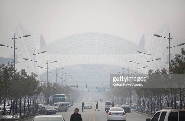 SHENYANG Nov 10 2015 The city is cloaked by smog in Shenyang capital of northeast China's Liaoning Province Nov 10 2015 Heavy air pollution in...