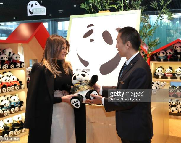 US First Lady Melania Trump receives a giant panda doll during her visit to the giant panda enclosure at the Beijing Zoo in Beijing capital of China...
