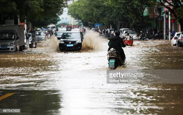 HEZHOU Nov 13 2015 Vehicles run on flooded road in Hezhou City south China's Guangxi Zhuang Autonomous Region Nov 13 2015 Heavy rainfall in recent...