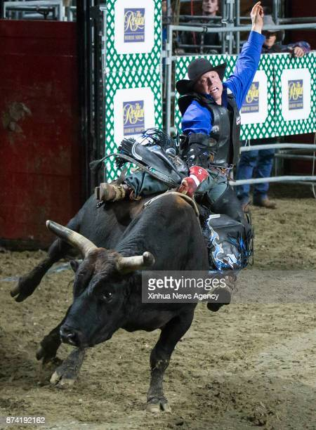 Cowboy Eric Isabelle of Canada competes during the Bull Riding competition of the Rodeo section at the 2017 Royal Horse Show in Toronto Canada Nov 12...