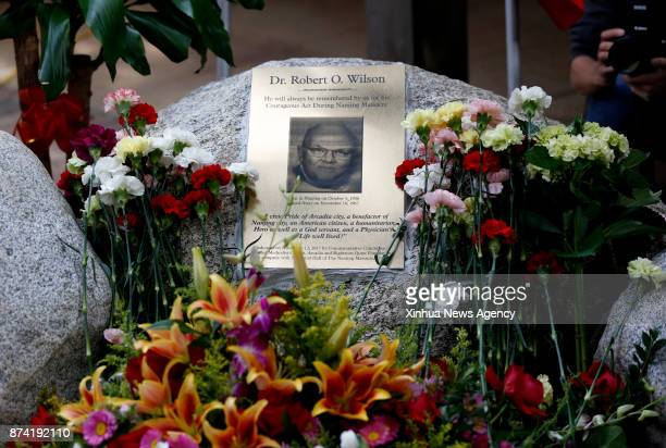 Flowers are presented to Dr Robert Wilson's memorial tablet after its unveiling in Los Angeles the United States Nov 12 2017 Dr Robert Wilson an...