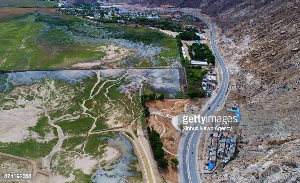 Photo taken on May 11 2017 shows the highway which runs near Lalu wetland in Lhasa southwest China's Tibet Autonomous Region Highways have been built...