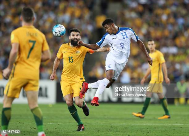 Mile Jedinak of Australia vies with Antony Lozano of Hunduras during the FIFA world cup 2018 Qualifiers intercontinental Playoff match between...