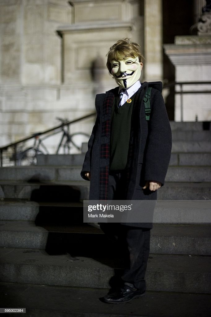 Nov 17 2011 London England UK A boy wearing a Guy Fawkes mask with the group Anonymous joins hundreds of protestors camping outside St Paul's...