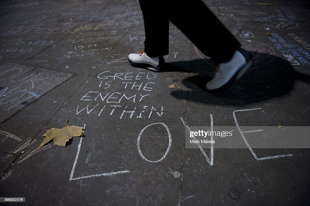 Nov 17 2011 London England UK Chalked messages including reading 'Greed is the Enemy within Love' are drawn outside St Paul's Cathedral as part of...
