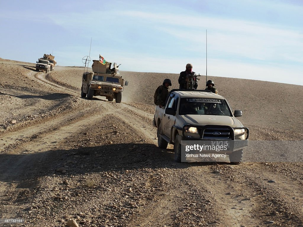 KABUL Nov 18 2015 Photo taken on Nov 17 2015 shows running military vehicles during a military operatin in Musa Qala district of the southern Helmand...