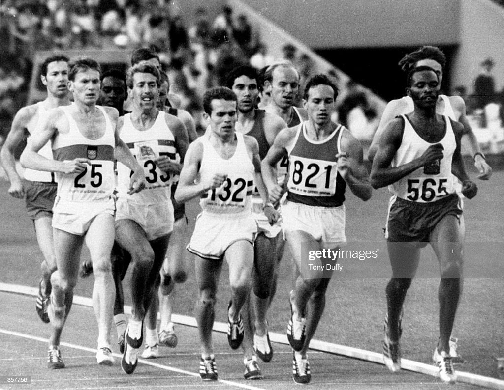 Kipchoge Keino (KEN), winner of the men''s 1500 meters, leads the field in his heat during 1968 Olympics in Mexico City.