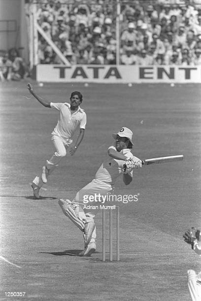 Ian Botham of England hooks Kapil Dev of India during the 1st Test in Bombay Mandatory Credit Adrian Murrell/Allsport UK