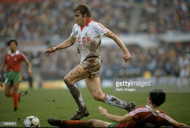 Demianenko of Russia runs past Jose Luis of Portugal during the European Championship qualifying match against Portugal played in Lisbon Portugal...