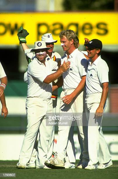 England players congratulate Graham Dilley during the First Ashes Test match against Australia at Woolloongabba in Brisbane Australia England won the...