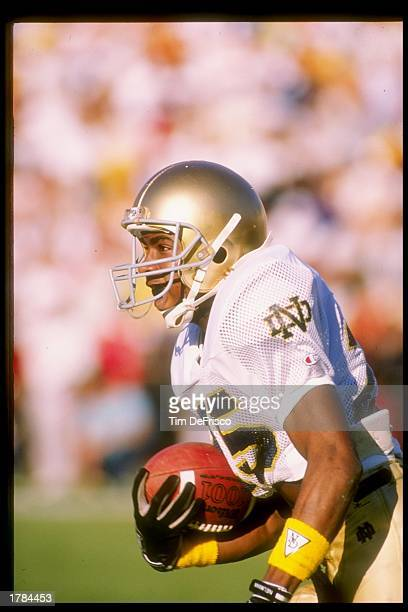 Flanker Raghib Ismail of the Notre Dame Fighting Irish runs down the field during a game against the Southern California Trojans at the Los Angeles...