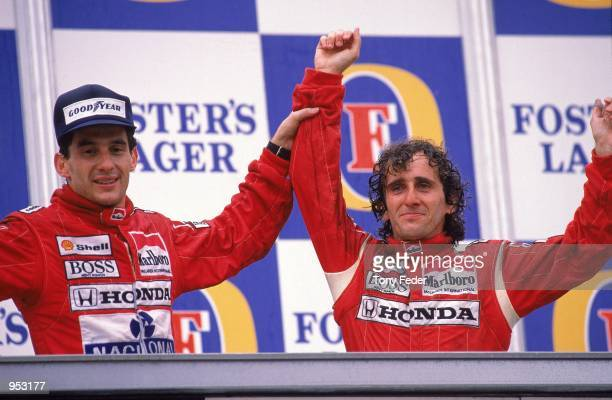 McLaren Honda driver Alain Prost of France celebrates his victory with teammate Ayrton Senna of Brazil who finished second after the Australian...