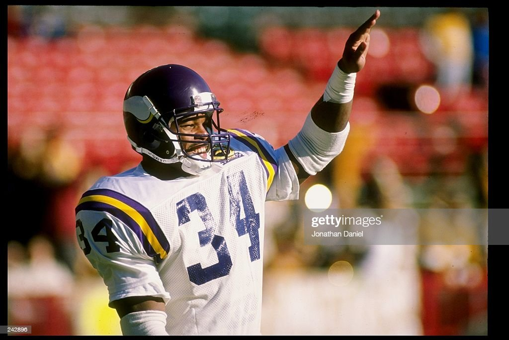 Running back Herschel Walker of the Minnesota Vikings looks on during a game against the Green Bay Packers at Lambeau Field in Green Bay Wisconsin...