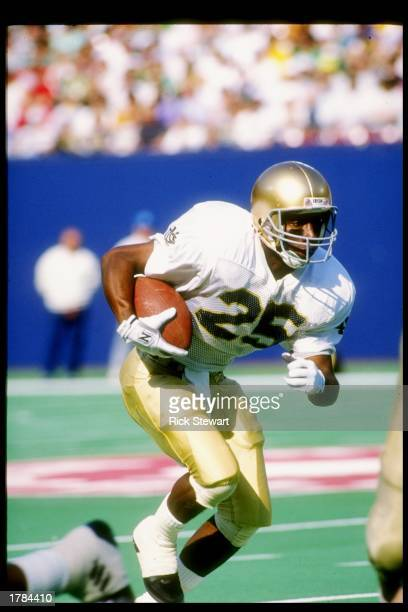 Flanker Raghib Ismail of the Notre Dame Fighting Irish runs down the field during a game against the Navy Midshipmen at Giants Stadium in East...