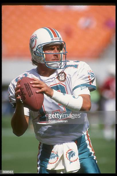 Quarterback Dan Marino of the Miami Dolphins looks to pass the ball during a game against the Arizona Cardinals at Sun Devil Stadium in Tempe Arizona...