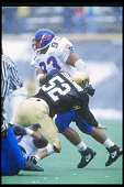 Defensive tackle Gilbert Brown of the Kansas Jayhawks fends off defenders during a game against the Colorado Buffaloes at Folsom Field in Boulder...