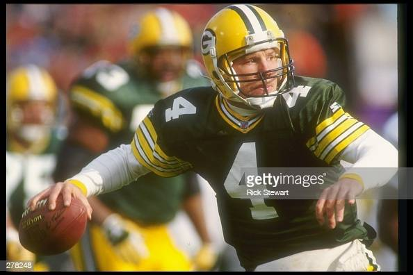 Quarterback Brett Favre of the Green Bay Packers looks to pass the ball during a game against the Philadelphia Eagles at the Milwaukee County Stadium...