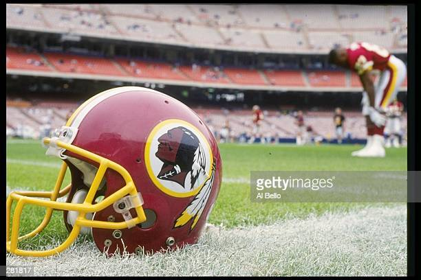 A Washington Redskins helmet lies on the field during a game against the Los Angeles Rams at Anaheim Stadium in Anaheim California The Rams won the...