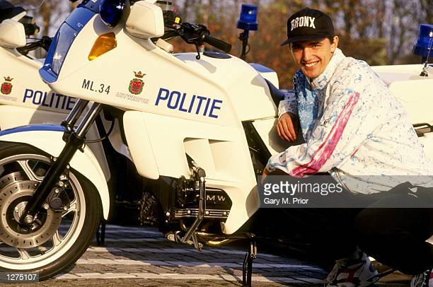 Goran Ivanisevic of Croatia poses next to a Police motorcyle during a feature in Antwerp Belgium Mandatory Credit Gary M Prior/Allsport