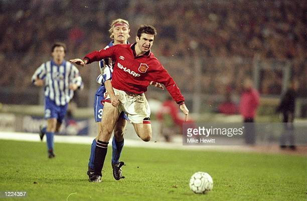 Eric Cantona of Manchester United is grabbed from behind during a Champions League match against Gothenburg in Gothenburg Sweden Gothenburg won the...